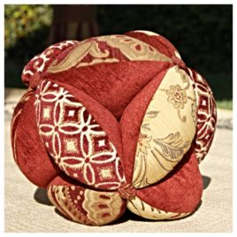 Sacred Geometry Energy Ball Pillow – 10″ Brick/ Cream